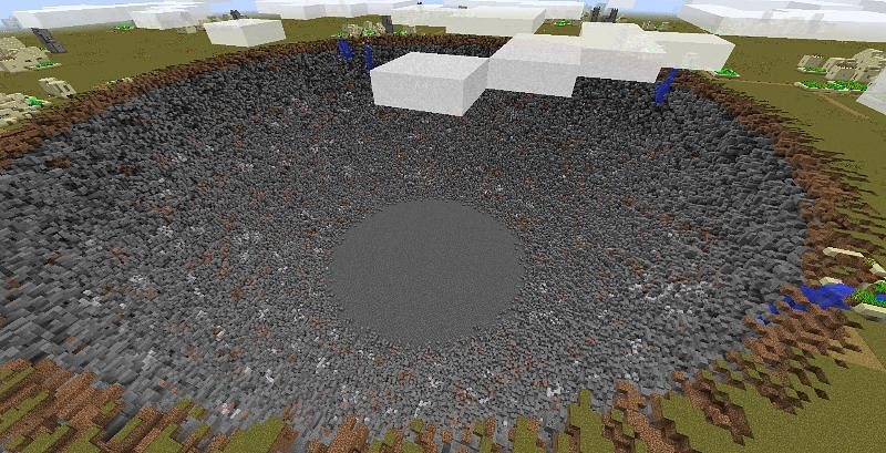 A massive crater caused by the Super TNT mod, which adjusts the strength of explosions (Image via lolyoujellybro.com)