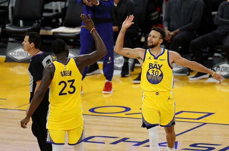 Stephen Curry celebrates with Draymond Green
