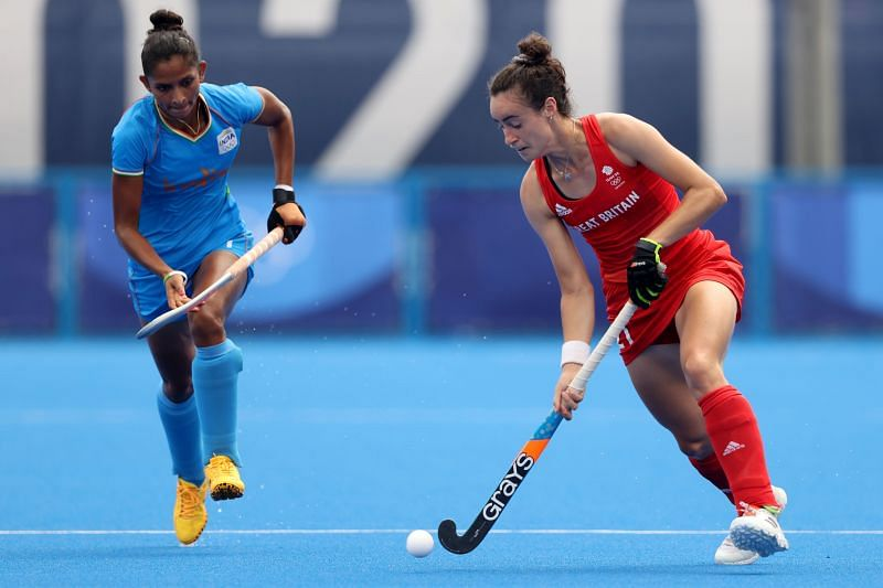 Fiona Anne Crackles of Team Great Britain moves the ball past Navjot Kaur of Team India during the Women's Preliminary Pool A match on Day 5 of Olympics 2021