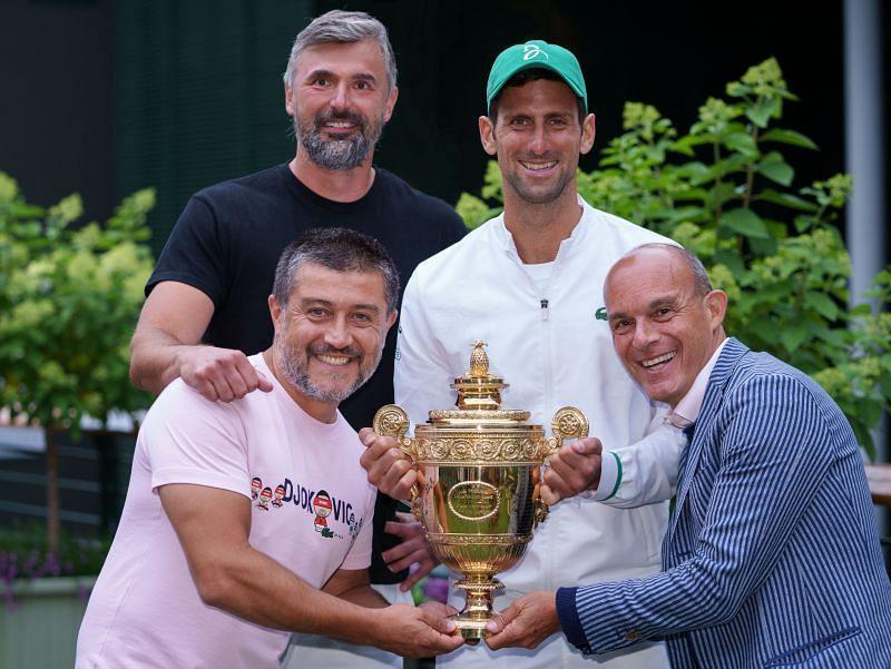 Novak Djokovic and his team pose with the Wimbledon title