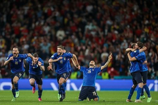 Italy players exult after winning the semi-final shootout against Spain