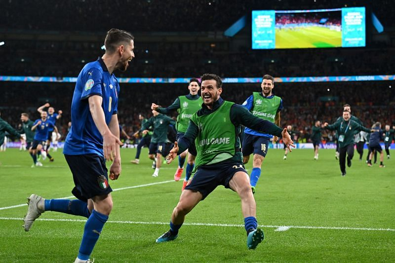 Italy players rejoice following their penalty-shootout victory against Spain.