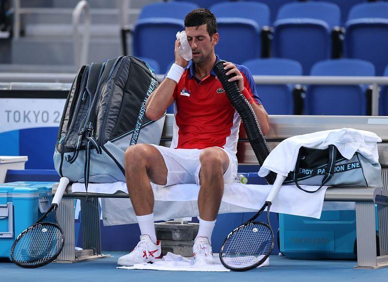 Novak Djokovic tries to cool himself during play