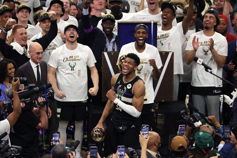Giannis Antetokounmpo #34 celebrates winning the Bill Russell NBA Finals MVP Award.
