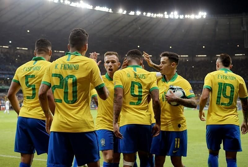 Brazil players celebrate one of their two goals against Argentina