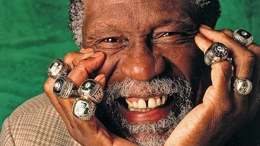 Bill Russell with his 11 NBA championship rings [Source: 2014 NBAE]