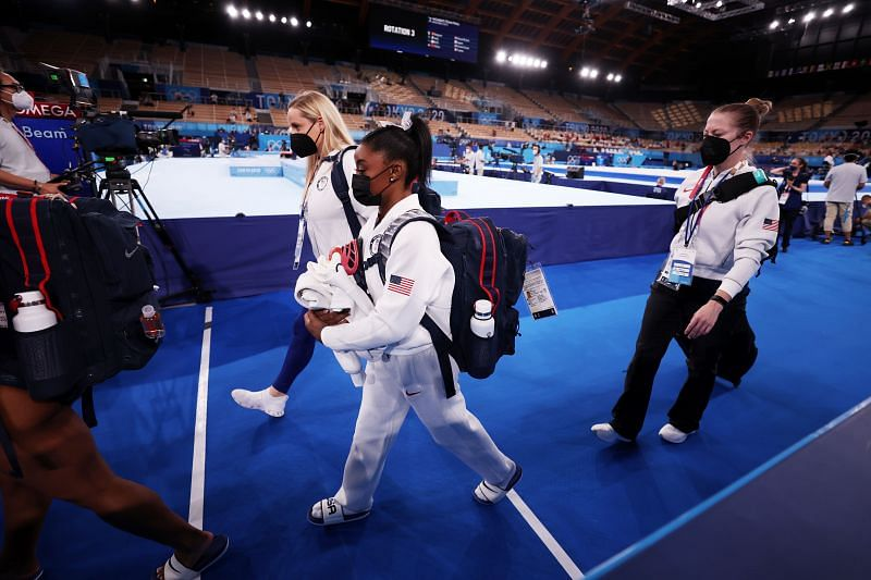 Simone Biles walking off the arena after a suspected injury