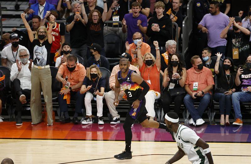 Chris Paul #3 celebrates a basket.