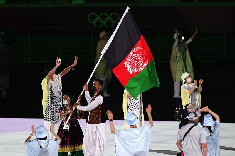 Flag bearers Kimia Yousofi and Farzad Mansouri of Team Afghanistan during the Opening Ceremony