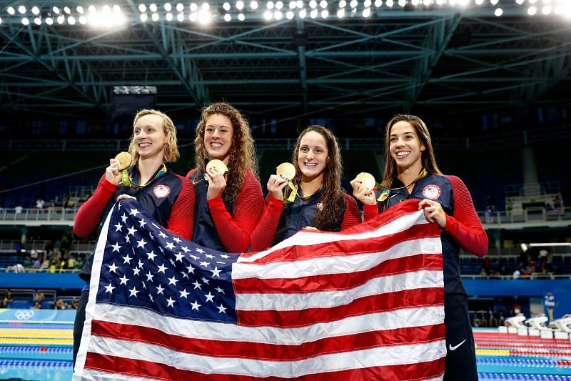 Gold medalists Allison Schmitt, Leah Smith, Maya Dirado and Katie Ledecky of the United States pose on the podium during the medal ceremony for the Women's 4 x 200m Freestyle Relay Final on Day 5 of the Rio 2016 Olympic Games at the Olympic Aquatics Stadium on August 10, 2016 in Rio de Janeiro, Brazil.