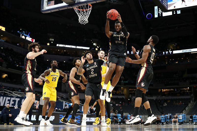 RaiQuan Gray (#1) grabs a rebound against the Michigan Wolverines.