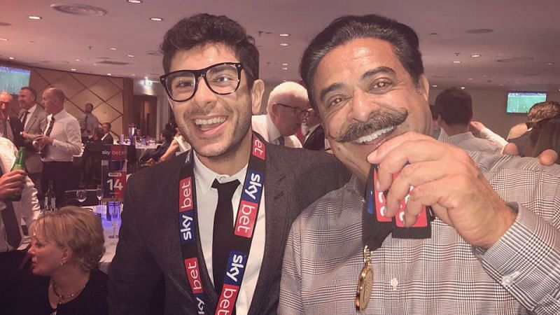 Tony Khan with his father, Shad Khan