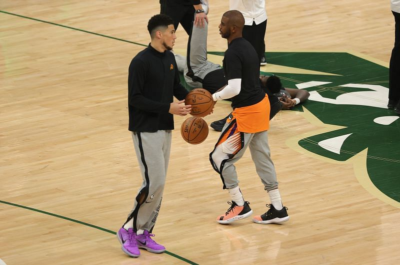 Devin Booker #1 and Chris Paul #3 warm up before Game 4.