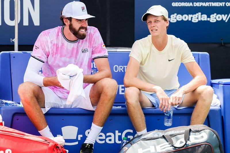 Jannik Sinner (R) with his doubles partner Reilly Opelka (L)