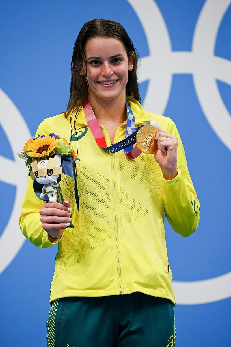 Kaylee McKeown of Team Australia poses with the gold medal after winning the Women's 100m Backstroke Final on day four of the Tokyo 2020 Olympic Games