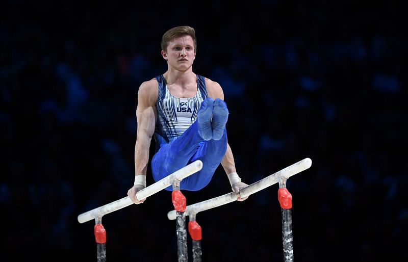 Allan Bower of the USA competes on the parallel bars during the 2019 Gymnastics World Cup at the Resorts World Arena on March 23, 2019 in Birmingham, England. (Photo by Shaun Botterill/Getty Images)