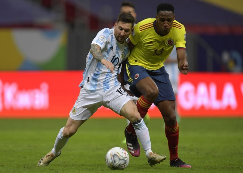 Yerry Mina (right) fights for the ball against Lionel Messi during the Copa America 2021 semifinal