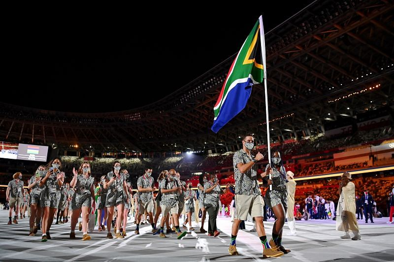 Flag bearers Phumelela Luphumlo Mbande and Chad Le Clos of Team South Africa lead their team out during the Opening Ceremony of the Tokyo 2020 Olympic Games