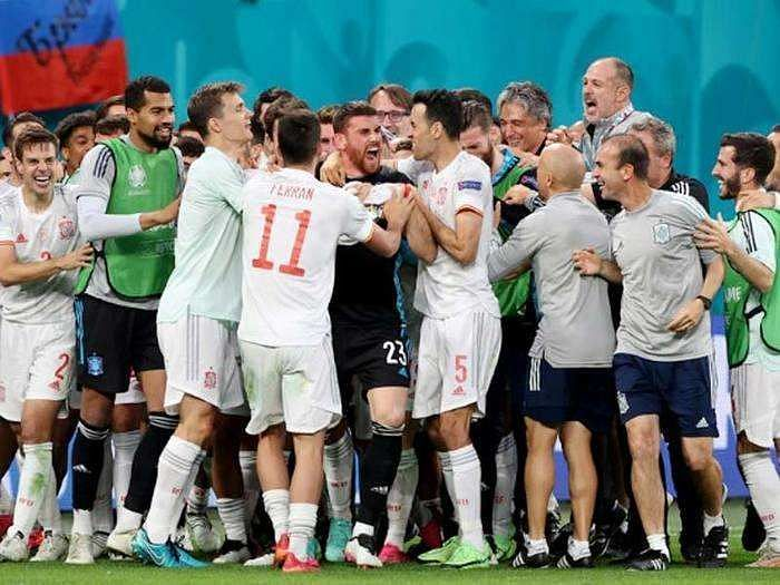 Spain players celebrate after their Euro 2020 penalty shootout win against Switzerland.