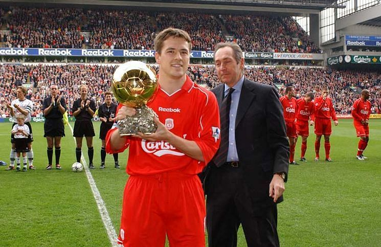 Michael Owen poses with his 2001 Ballon d