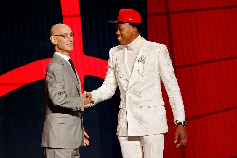Scottie Barnes (right) is greeted by NBA commissioner Adam Silver