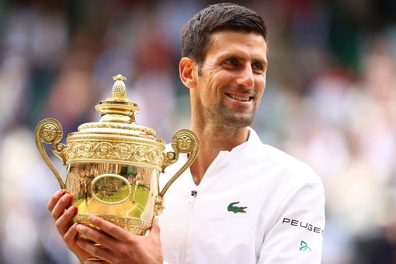 Novak Djokovic is all smiles after hoisting his 20th Grand Slam title aloft at Wimbledon 2021.