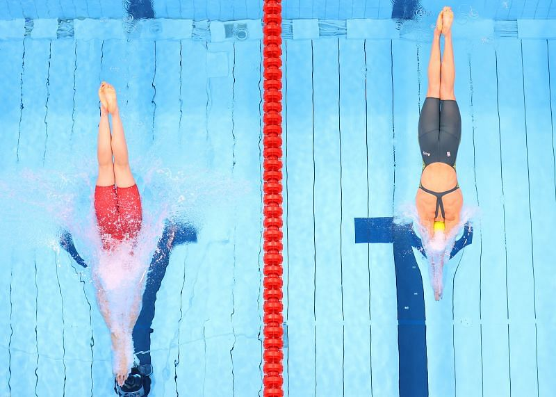 Penny Oleksiak of Team Canada and Ariarne Titmus of Team Australia compete in the Women's 200m Freestyle Semifinal on day four of the Tokyo 2020 Olympic Games