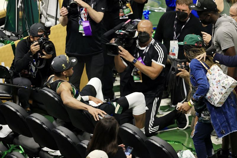 Giannis Antetokounmpo #34 of the Milwaukee Bucks sits on the bench for a moment after defeating the Phoenix Suns in Game Six to win the 2021 NBA Finals.