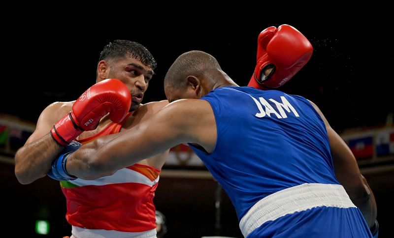 Satish Kumar (in red) will take on the formidable Bakhodir Jalolov on Sunday