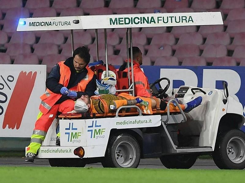 David Ospina taken off on a stretcher after collapsing on the pitch.