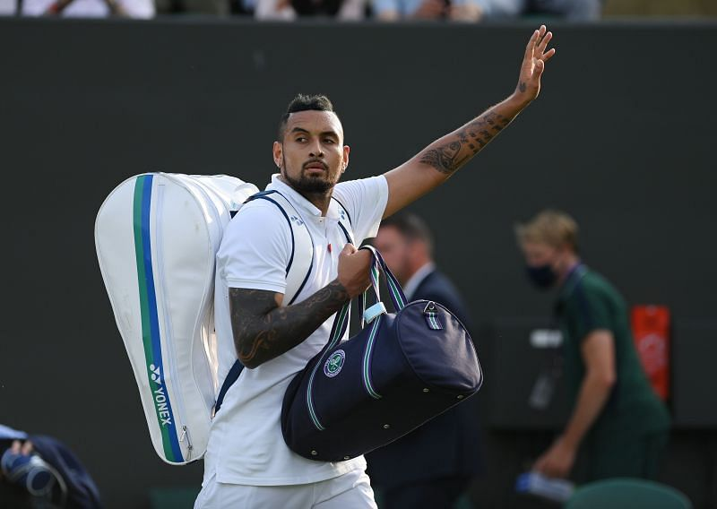 Nick Kyrgios acknowledges the crowd after reaching the third round at Wimbledon.