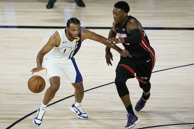 T.J. Warren #1 of the Indiana Pacers drives into Bam Adebayo #13 of the Miami Heat