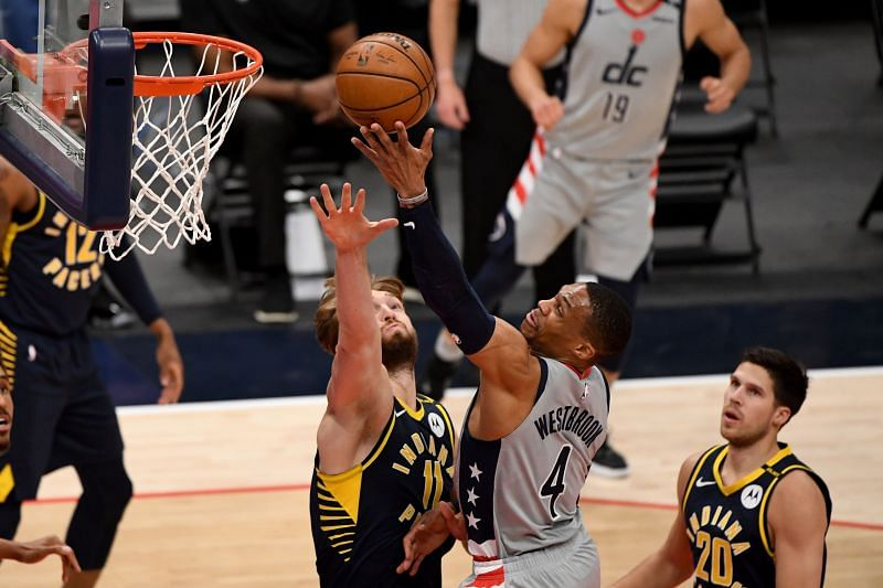 Russell Westbrook #4 of the Washington Wizards shoots in front of Domantas Sabonis #11 of the Indiana Pacers