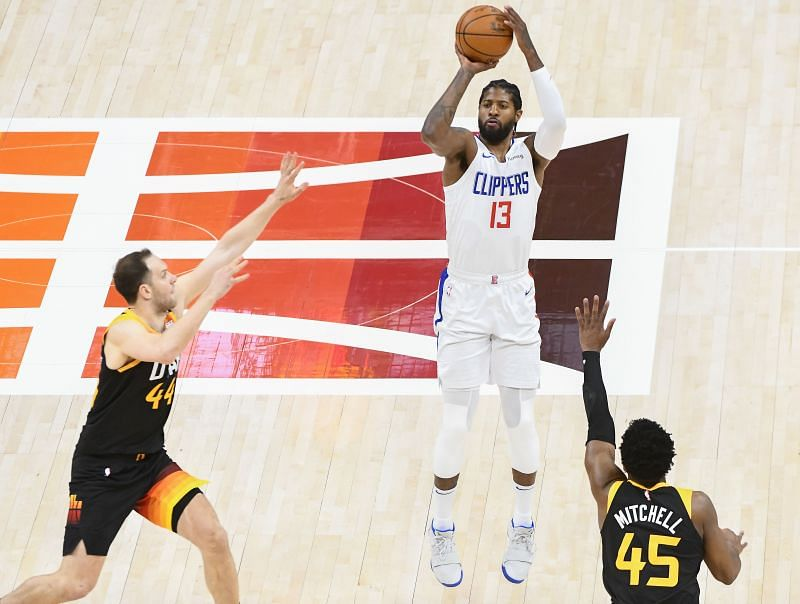 Paul George #13 of the Los Angeles Clippers shoots against Donovan Mitchell #45 and Bojan Bogdanovic #44 of the Utah Jazz
