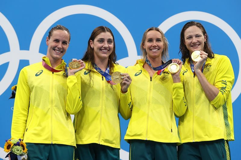 Australia women's swimming team poses with their gold medals in the women's 4x100 metre freestyle relay finals at Tokyo Olympics 2020