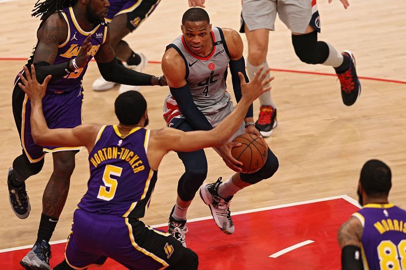 Russell Westbrook #4 looks to pass in front of Talen Horton-Tucker #5
