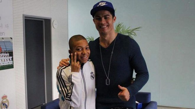 Cristiano Ronaldo with a young Kylian Mbappe (left)