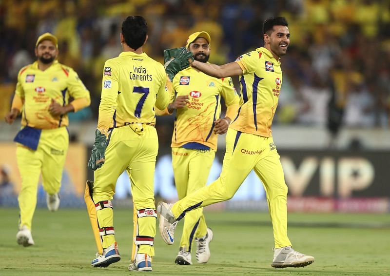 Deepak Chahar celebrating a fall of a wicket with MS Dhoni in CSK colors.