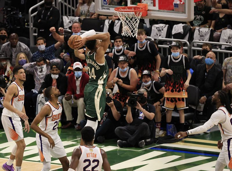 Giannis Antetokounmpo #34 goes up for a dunk.