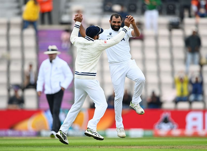 Mohammed Shami (R) celebrates a wicket
