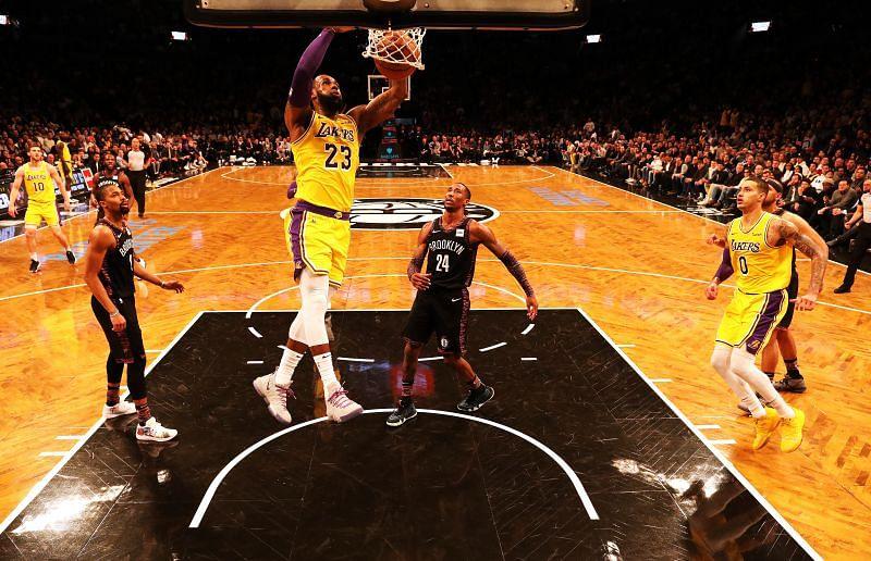 LeBron James #23 dunks against Rondae Hollis-Jefferson #24.