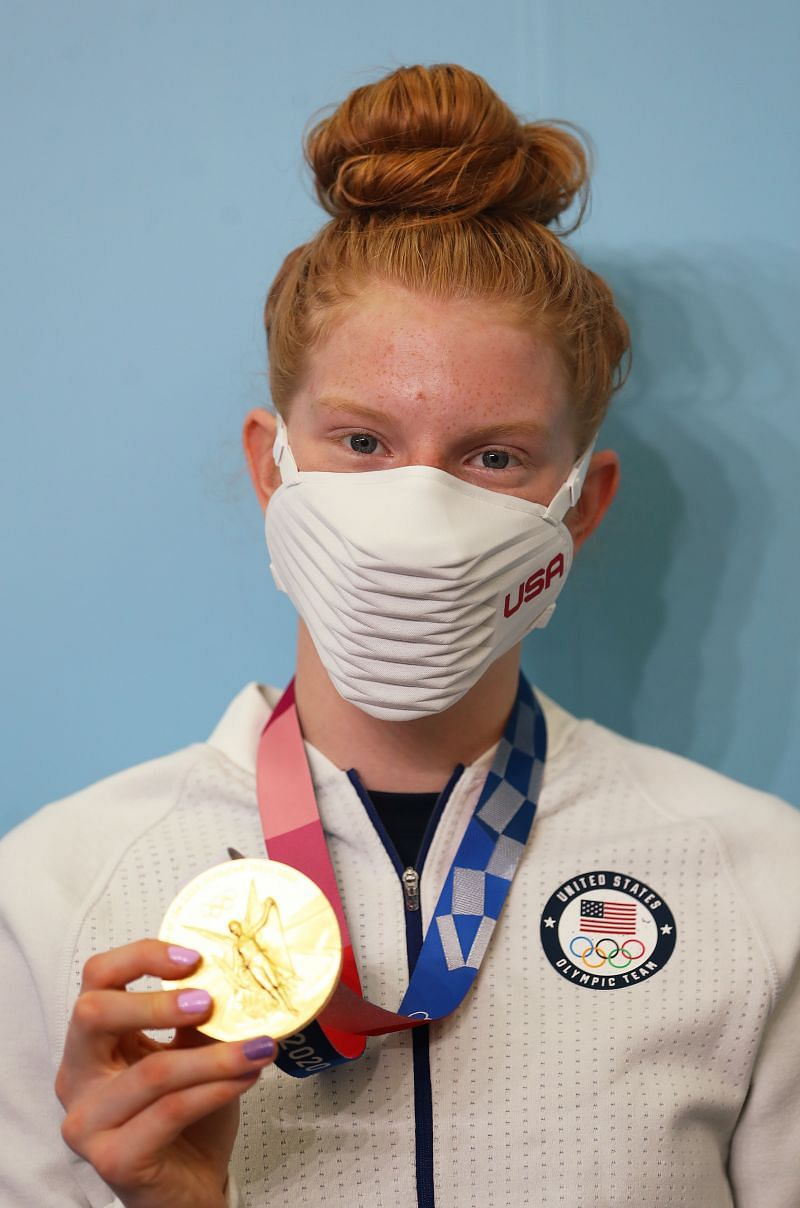 Lydia Jacoby of Team United States poses for a photo with her gold medal which she won in the Women's 100m breaststroke