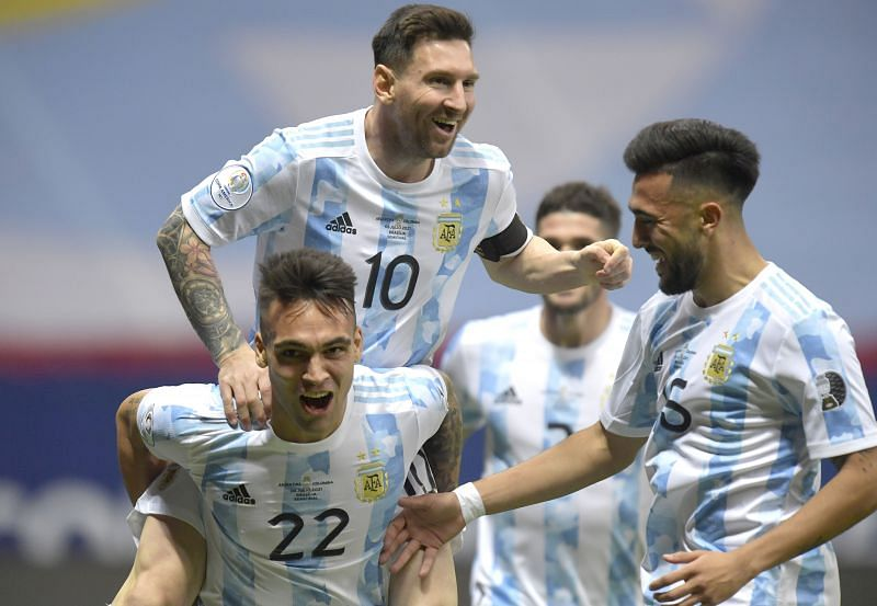 Lionel Messi (#10) exults after Lautaro Martinez (#22) scored off his assist against Colombia.