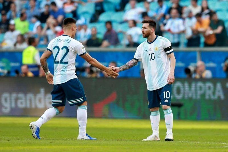 Laurato Martinez (left) and Lionel Messi