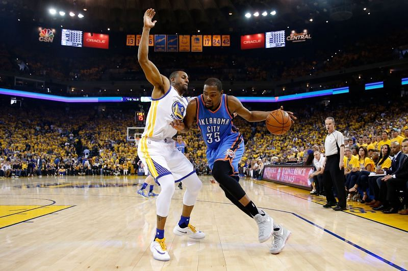 Kevin Durant #35 drives with the ball against Andre Iguodala #9
