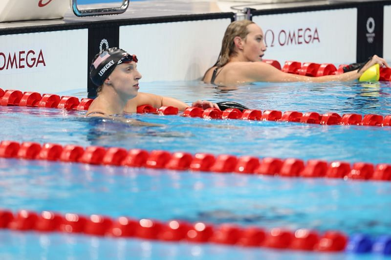 Katie Ledecky of Team United States and Madison Wilson of Team Australia look on during the Women's 200m Freestyle Semifinal 2 on day four of the Tokyo 2020 Olympic Games