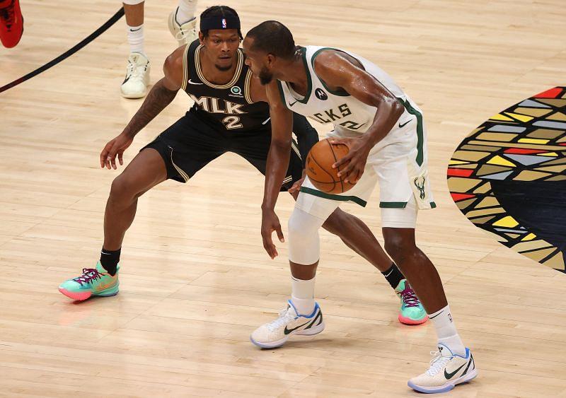 Cam Reddish #22 of the Atlanta Hawks defends Khris Middleton #22 of the Milwaukee Bucks