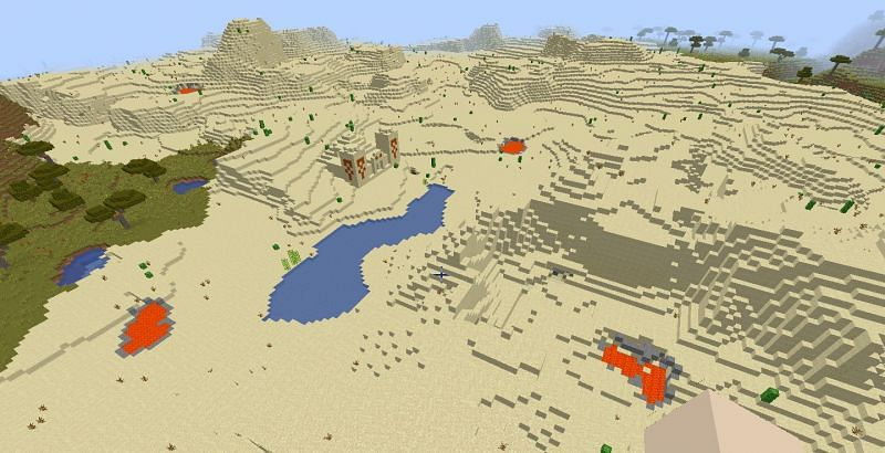 A desert biome with four visible lava pools (Image via Minecraft)