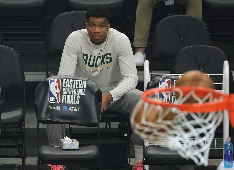 Giannis Antetokounmpo watches on from the sidelines