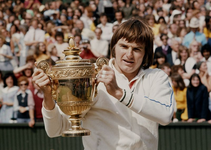 Jimmy Connors poses with the Wimbledon title in 1974
